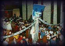 Giant puppet looms over audience